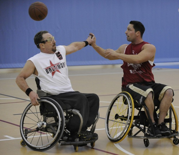 Ron Shaffer and his son Mike Shaffer fight for the loose ball during practice for Maryland Ravens. (Gene Sweeney Jr./Baltimore Sun)