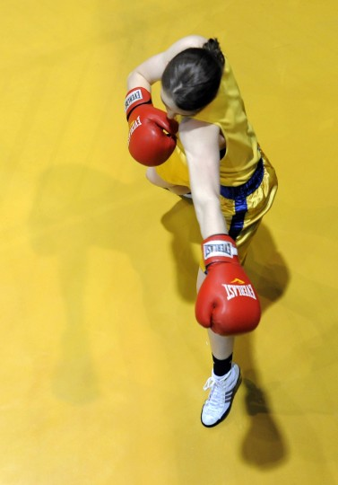 Midshipman Sam Glaeser gets ready for her 139 pound bout to begin. (Lloyd Fox/Baltimore Sun)