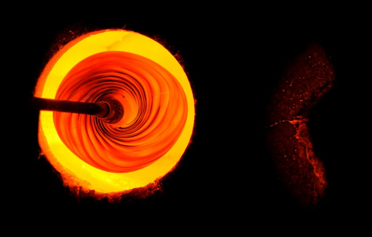 "A glass sculpture is heated at 2500 degrees in the ""glory hole."" It is then reshaped and cooled. (Lloyd Fox/Baltimore Sun)"