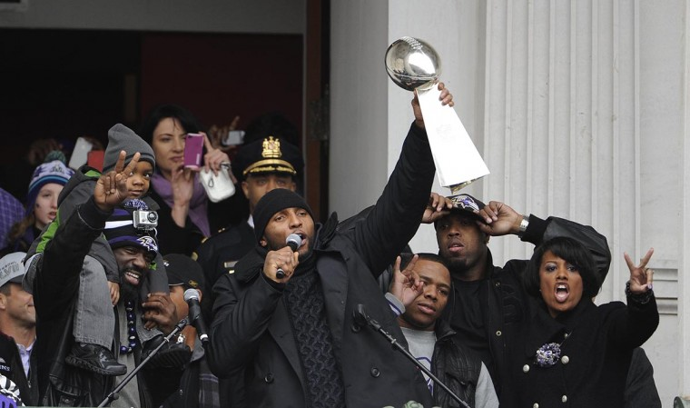 Ray Lewis lifts the Lombardi Trophy as he greets the crowd at the Ravens Superbowl parade, which started at City Hall. (Barbara Haddock Taylor/Baltimore Sun)