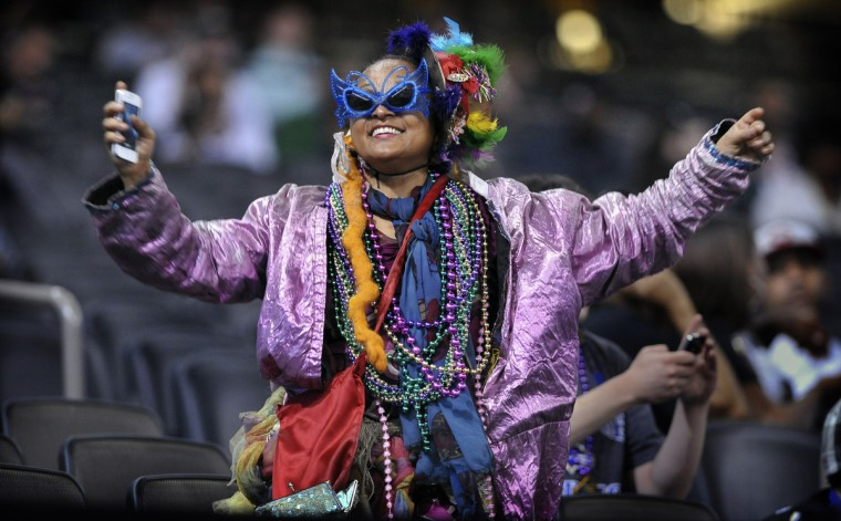 Football fan Jennifer Jones dances in the stands during Media Day for the NFL's Super Bowl XLVII. Fans were allowed in the stands during media day for a nominal charge. (Gene Sweeney Jr./Baltimore Sun)