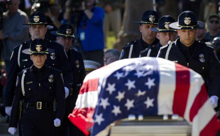 The Riverside, California, police Honor Guard approaches the casket of slain Riverside police officer Michael Crain during a memorial service at Riverside National Cemetery. Crain was killed in an ambush by renegade ex-cop Christopher Dorner as he sat in his police car at a red light on February 7, 2013. (Gina Ferazzi/Los Angeles Times)