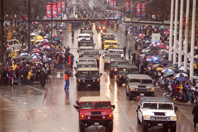 Jan. 30, 2001 — Ravens players are driven through Baltimore Streets in Hummers for the Baltimore Ravens Super Bowl XXXV Victory Parade. (Perry Thorsvik/Baltimore Sun)