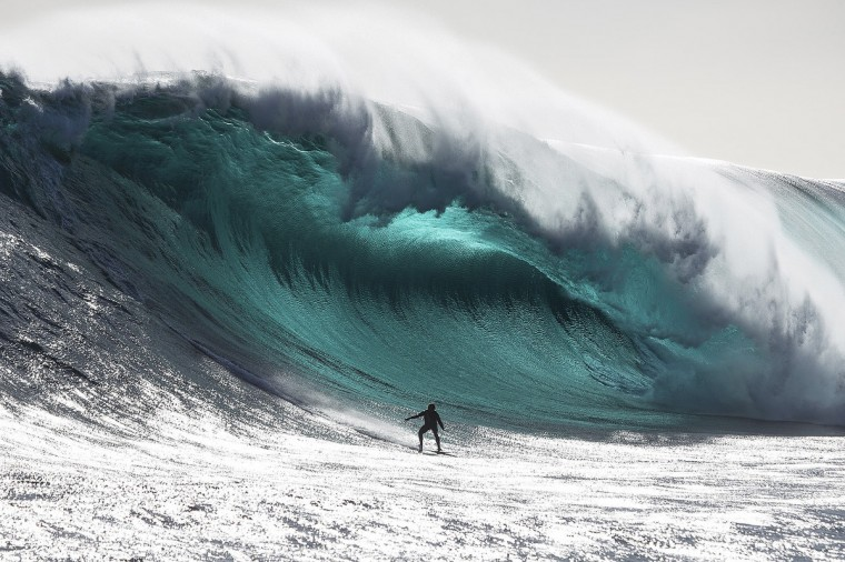 Australian surfer Marti Paradisis rides a wave near Pedra Branca Rock, south of Tasmania in the Southern Ocean in this in this file photograph taken in November 2012 in this picture provided by Big Wave Awards. Paradisis won the 'Biggest Wave' section of the Australiasian Big Wave Awards, which included $20,000 prize-money. (Andrew Chisholm/Big Wave Awards)