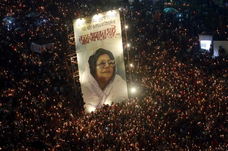 Millions attend a mass candlelight vigil around a portrait of Jahanara Imam, a late political activist pioneer widely known to bring the accused of committing war crimes in the Bangladesh Liberation War to trial, at Shahbagh intersection in Dhaka February 14, 2013. (Andrew Biraj/Reuters)