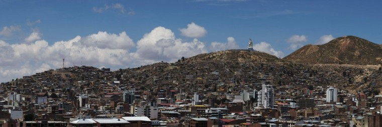 A general view of part of Oruro city and a statue of the Virgin of the Socavon, the patron saint of miners, is seen during its inauguration at Santa Barbara hill, some 200 km (124 miles) south of La Paz, Bolivia. The statue measures 45 metres (148 feet) in height and stands at 3,850 meters (12,631 feet) above sea level according to its sculptors. (David Mercado/Reuters)