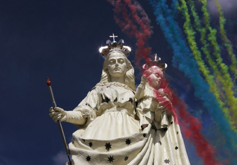 Fireworks are seen at the inauguration of the statue of the Virgin of the Socavon, the patron saint of miners, at Santa Barbara hill on the outskirts of Oruro, some 200 km (124 miles) south of La Paz, Bolivia. (David Mercado/Reuters)