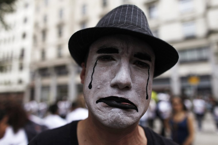 A man, with his face painted as a mime, takes part in a block street parade against the sexual exploitation of children and adolescents, ahead of the annual Brazilian Carnival, in Sao Paulo. The annual Brazilian Carnival starts Friday. (Nacho Doce/Reuters)
