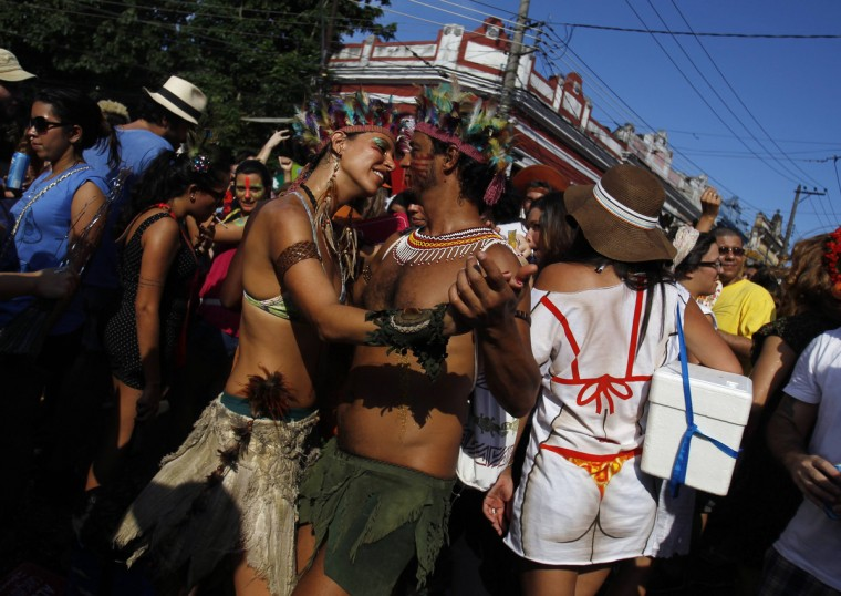"Revellers dance during an annual block party known as ""Ceu na Terra"" (or Sky on Earth), one of the many carnival parties to take place in the neighbourhoods of Rio de Janeiro February 2, 2013. (Pilar Olivares/Reuters)"