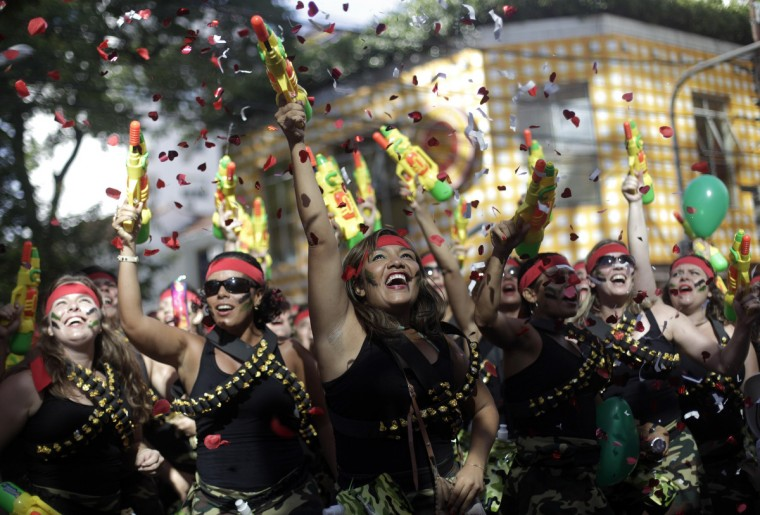 "Revellers dance during the annual block party known as the ""Suvaco do Cristo"" (Armpit of Christ), one of the many pre-carnival parties to take place in the neighbourhoods of Rio de Janeiro February 3, 2013. (Ricardo Moraes/Reuters)"