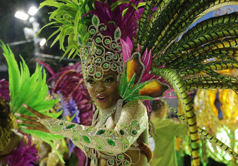 A reveller from the Mangueira samba school participates during the annual carnival parade in Rio de Janeiro's Sambadrome, February 11, 2013. (Sergio Moraes/Reuters)