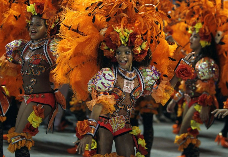 Revellers of the Salgueiro samba school participate on the first night of the annual carnival parade in Rio de Janeiro's Sambadrome, February 10, 2013. (Pilar Olivares/Reuters)