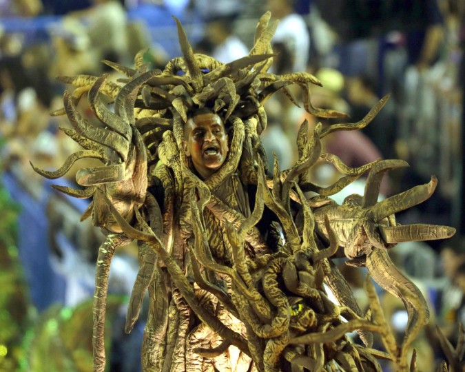 A reveller from the Vila Isabel samba school participates in the annual Carnival parade in Rio de Janeiro's Sambadrome February 12, 2013. (Ricardo Moraes/Reuters)