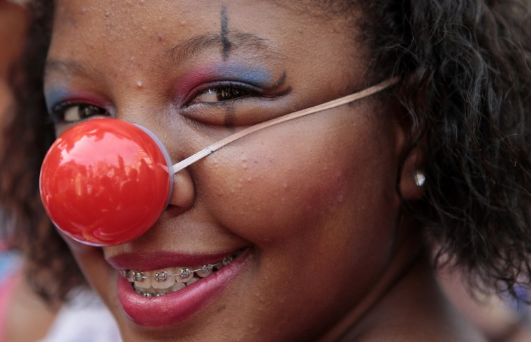 "A reveller performs during the annual block party known as the ""Gigantes da Lira"", one of the many carnival parties to take place in the neighbourhoods of Rio de Janeiro February 3, 2013. (Sergio Moraes/Reuters)"