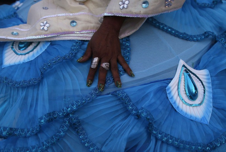 The hand of a reveller is seen as she dresses outside the Sambadrome for the first night of the annual Carnival parade in Rio de Janeiro, February 10, 2013. (Pilar Olivares/Reuters)