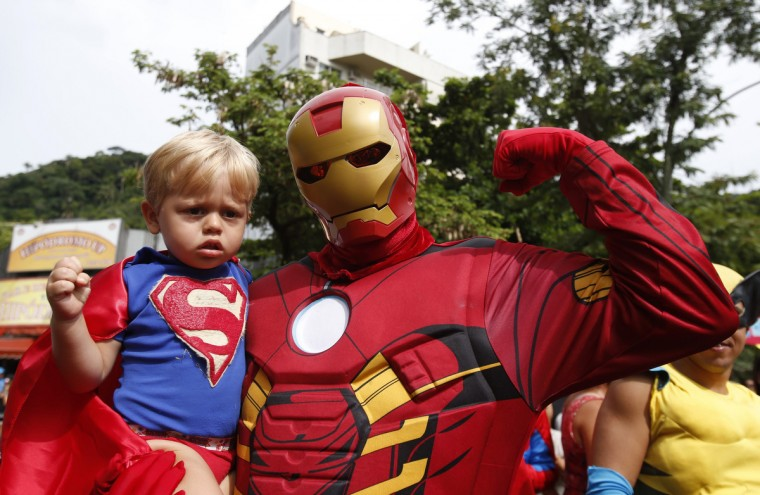 "A reveller dressed as ""Iron Man"" and a child dressed as ""Superman"" take part in the ""Desliga da Justica"" carnival parade during pre-carnival festivities in Rio de Janeiro January 26, 2013. (Sergio Moraes/Reuters)"