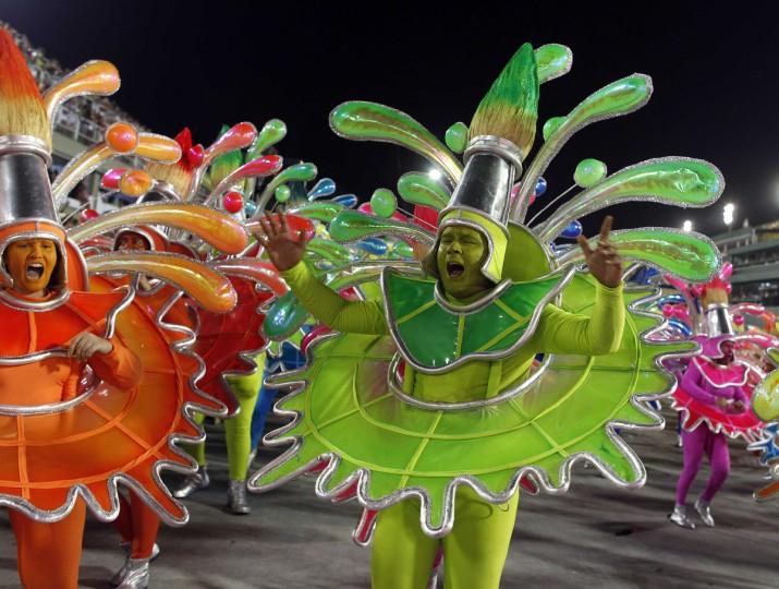 Revellers of the uniao da ilha Uniao da Ilha samba school participate on the first night of the annual Carnival parade in Rio de Janeiro's Sambadrome, February 11, 2013. (Pilar Olivares/Reuters)
