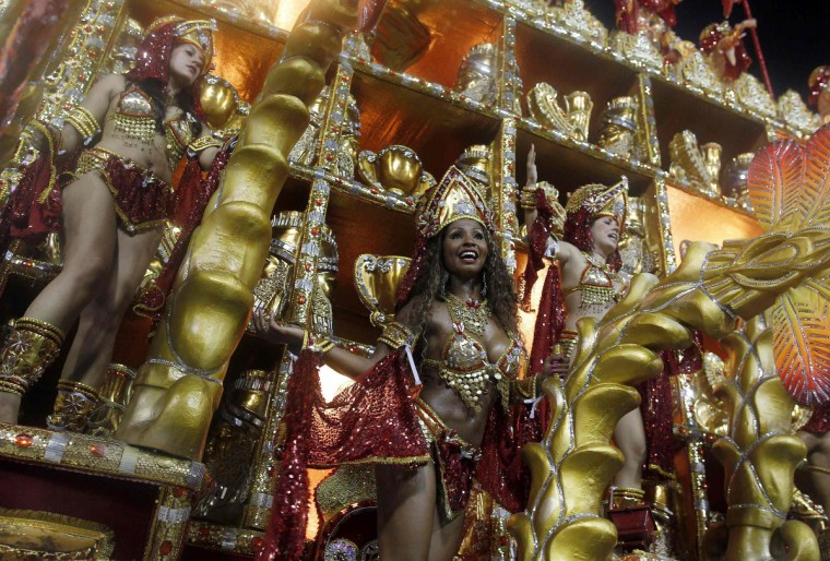 Revellers from the Beija Flor samba school participate during the annual Carnival parade in Rio de Janeiro's Sambadrome, February 11, 2013. (Pilar Olivares/Reuters)