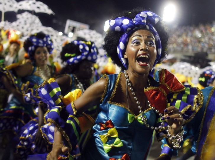Revellers of Portela samba school participate in the annual Carnival parade in Rio de Janeiro's Sambadrome, February 11, 2013. (Pilar Olivares/Reuters)