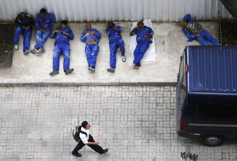 Workers from the Rio Museum of Art (MAR), or the Museu de Arte do Rio, relax during their lunch time, in Rio de Janeiro February 28, 2013. The museum will be inaugurated on Friday. (Sergio Moraes/Reuters)