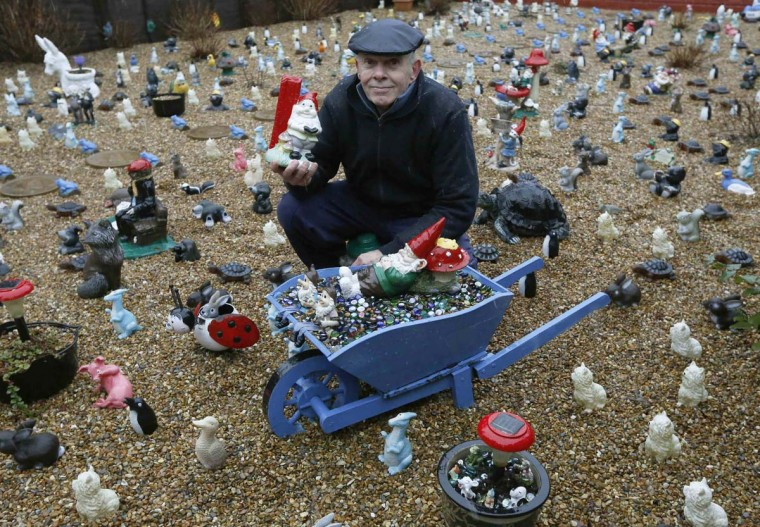 Nigel Balcombe poses with his rear garden filled with gnomes and other ornaments in Ashford, south east England February 10, 2013. Britain's Royal Horticultural Society (RHS) said it will overturn a ban on garden gnomes, for one season only, at the 100th anniversary of its Chelsea Flower Show in the summer of 2013. The RHS is inviting celebrities to paint and decorate gnomes to be auctioned off to raise funds for its nationwide RHS Campaign for School Gardening. (Luke MacGregor/Reuters)
