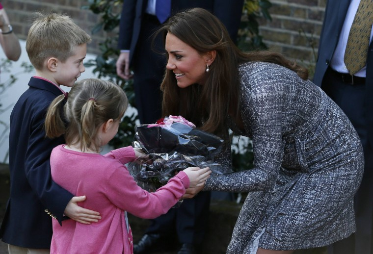 Britain's Catherine, Duchess of Cambridge receives flowers from children as she leaves Hope House addiction treatment centre after an official visit in London. (Stefan Wermuth/Reuters)