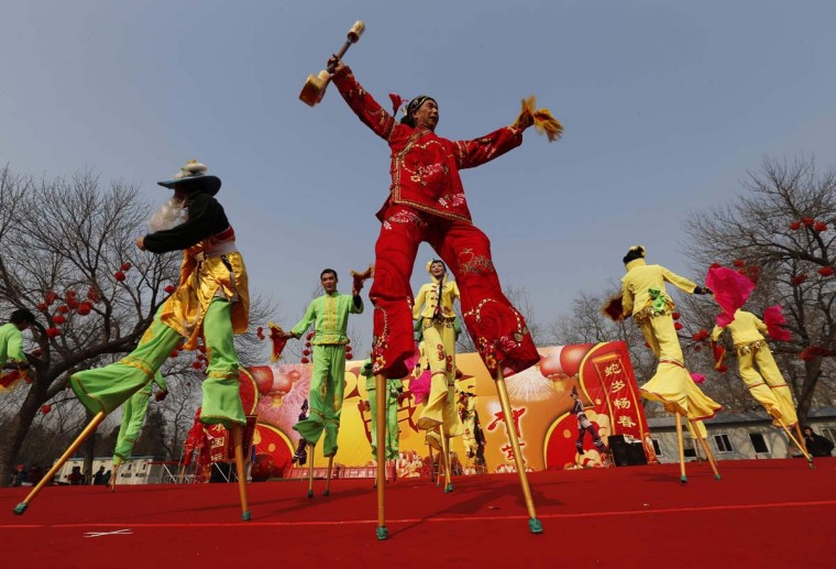 Folk artists perform on stilts at Longtan Park in Beijing February 9, 2013. The Lunar New Year, or Spring Festival, begins on February 10 and marks the start of the Year of the Snake, according to the Chinese zodiac. (Kim Kyung-Hoon/Reuters)
