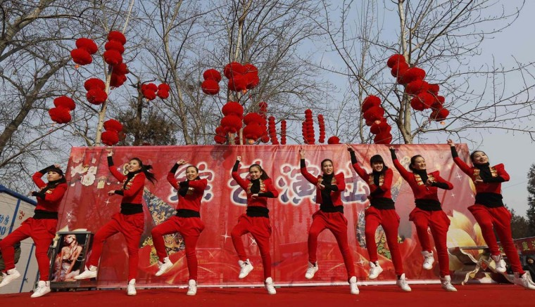 """Dancers perform to """"Gangnam Style"""" during the temple fair in Ditan Park, also known as the Temple of Earth, in Beijing February 9, 2013. The Lunar New Year, or Spring Festival, begins on February 10 and marks the start of the Year of the Snake, according to the Chinese zodiac. (Kim Kyung-Hoon/Reuters)"""