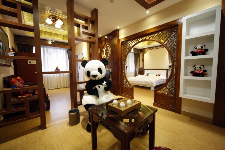 An employee dressed in a panda costume poses for a photo during the soft opening of a panda-themed hotel at the foot of Emei Mountain, in southwest China's Sichuan province. According to local media, the hotel is the first panda-themed hotel in the world and will officially open in May with room rates from 300 ($48) to 500 yuan per night. (China Daily)