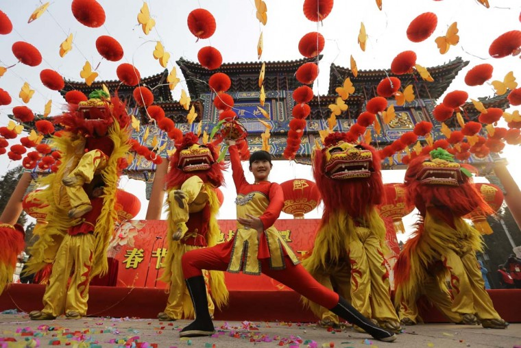 Chinese artists perform the lion dance during the opening ceremony of the Spring Festival Temple Fair at Ditan Park (the Temple of Earth), in Beijing, February 9, 2013. The Lunar New Year, or Spring Festival, begins on February 10 and marks the start of the Year of the Snake, according to the Chinese zodiac. (Jason Lee/Reuters)