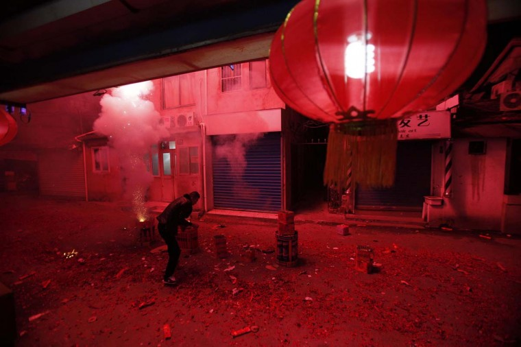 A man lights up fireworks as residents celebrate the start of the Chinese New Year in Shanghai February 9, 2013. The Lunar New Year, or Spring Festival, begins on February 10 and marks the start of the Year of the Snake, according to the Chinese zodiac. (Carlos Barria/Reuters)