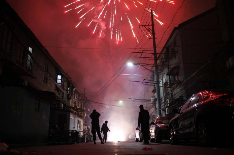 Men light up fireworks as residents celebrate the start of the Chinese New Year in Shanghai February 9, 2013. The Lunar New Year, or Spring Festival, begins on February 10 and marks the start of the Year of the Snake, according to the Chinese zodiac. (Carlos Barria/Reuters)