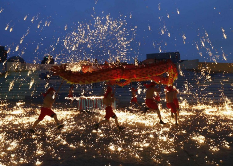 Dancers perform a fire dragon dance in the shower of molten iron spewing firework-like sparks during a folk art performance to celebrate traditional Chinese Spring Festival at an amusement park in Beijing February 10, 2013. The Lunar New Year, or Spring Festival, begun on February 10 and marked the start of the Year of the Snake, according to the Chinese zodiac. (Kim Kyung-Hoon/Reuters)