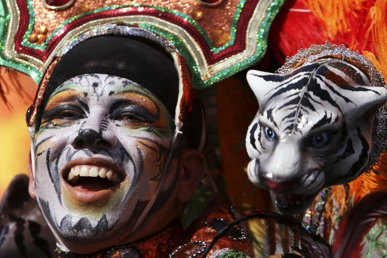 "A reveller performs during the ""Grand Parade of Tradition"" as part of Carnival celebrations in Barranquilla February 10, 2013. (Joaquin Sarmiento/Reuters)"