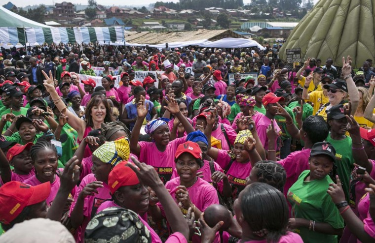 "Congolese women cheer during the global rally ""One Billion Rising"", which is part of the V-Day event calling for an end to gender-based violence, in Bukavu February 14, 2013. V-Day is a global activist movement to end violence against women and girls. (Jana Asenbrennerova/Reuters)"