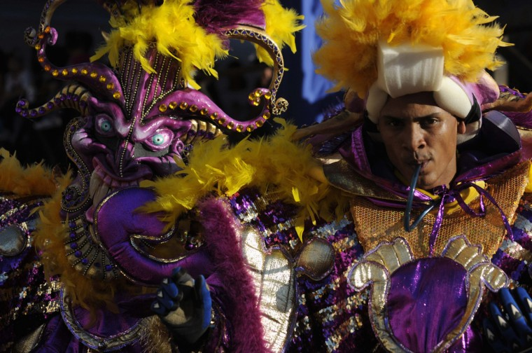 A masked reveller takes part in the annual Carnival parade in La Vega February 3, 2013. (Ricardo Rojas/Reuters)