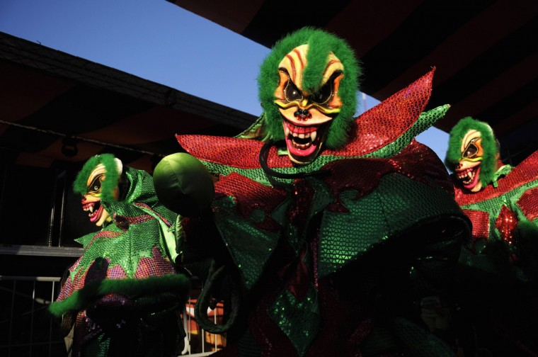 Masked revellers take part in the annual Carnival parade in La Vega February 3, 2013. (Ricardo Rojas/Reuters)
