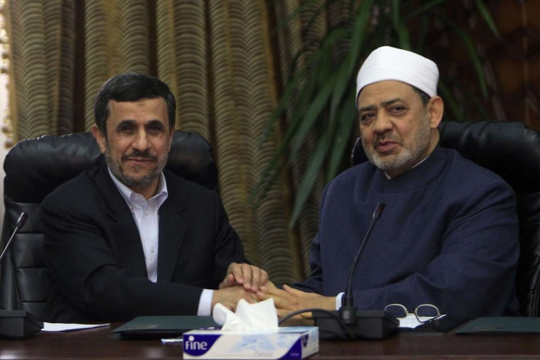 Iran's President Mahmoud Ahmadinejad (L) shakes hands with Al-Azhar's Grand Sheikh Ahmed al-Tayeb during their meeting in Cairo February 5, 2013. Al-Tayeb, Egypt's top Sunni Muslim scholar, told Ahmadinejad of Shi'ite Iran on Tuesday that his country must give full rights to Sunnis living in Iran and refrain from interfering in the affairs of Gulf Arab states.(Mohamed Abd El Ghany/Reuters)