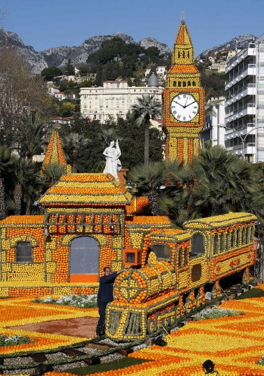 A worker puts the final touch to a train near a replica of Big Ben made with lemons and oranges during the 80th Lemon festival in Menton, France. Some 145 metric tons of lemons and oranges are used to make displays during the 80th festival, which is themed 'Around The World In 80 Days,' and runs from February 16 through March 6. (Eric Gaillard/Reuters)