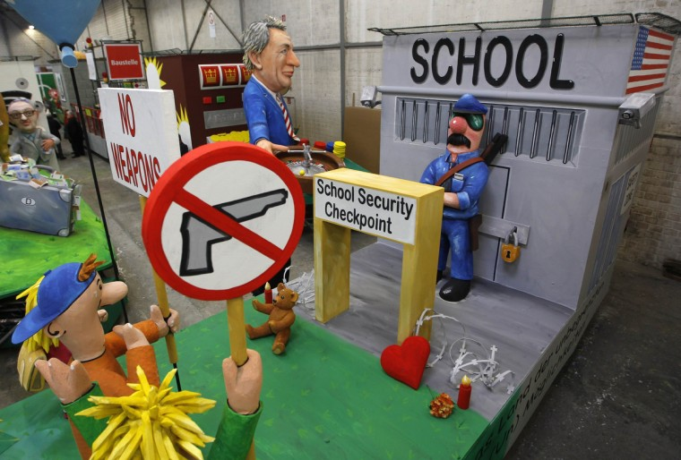 A papier-mache figure shows an American school with security checkpoint, on a float for the Rose Monday carnival procession during a preview in Cologne February 5, 2013. (Ina Fassbender/Reuters)