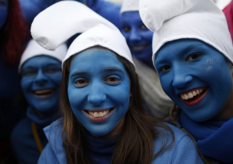 "Women dressed as Smurfs celebrate ""Weiberfastnacht"" (Women's Carnival) in Cologne February 7, 2013. Women's Carnival marks the start of a week of street festivals, the highlight of the event being ""Rosenmontag"" (Rose Monday), the final day of the carnival where mass processions are held.(Ina Fassbender/Reuters)"