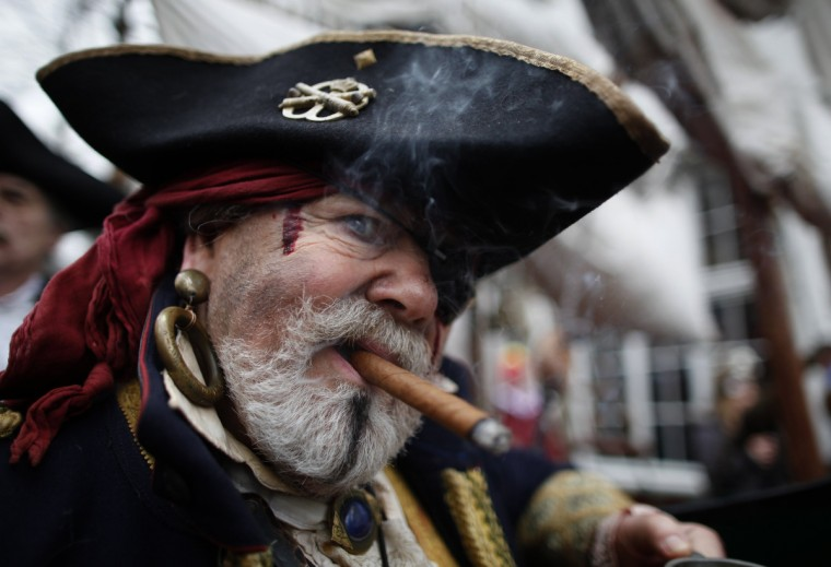 "A man dressed as pirate poses during ""Weiberfastnacht"" (Women's Carnival) in Cologne February 7, 2013. Women's Carnival marks the start of a week of street festivals, the highlight of the event being ""Rosenmontag"" (Rose Monday), the final day of the carnival where mass processions are held. (Ina Fassbender/Reuters)"