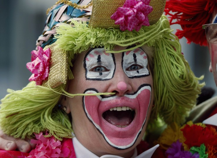 "A woman dressed as clown celebrates ""Weiberfastnacht"" (Women's Carnival) in Cologne February 7, 2013. Women's Carnival marks the start of a week of street festivals, the highlight of the event being ""Rosenmontag"" (Rose Monday), the final day of the carnival where mass processions are held. (Ina Fassbender/Reuters)"