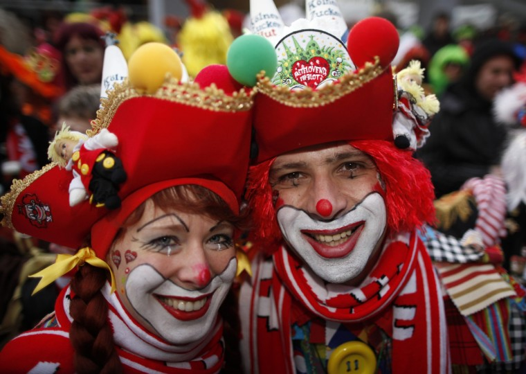 "A couple in costume celebrates ""Weiberfastnacht"" (Women's Carnival) in Cologne February 7, 2013. Women's Carnival marks the start of a week of street festivals, the highlight of the event being ""Rosenmontag"" (Rose Monday), the final day of the carnival where mass processions are held. (Ina Fassbender/Reuters)"