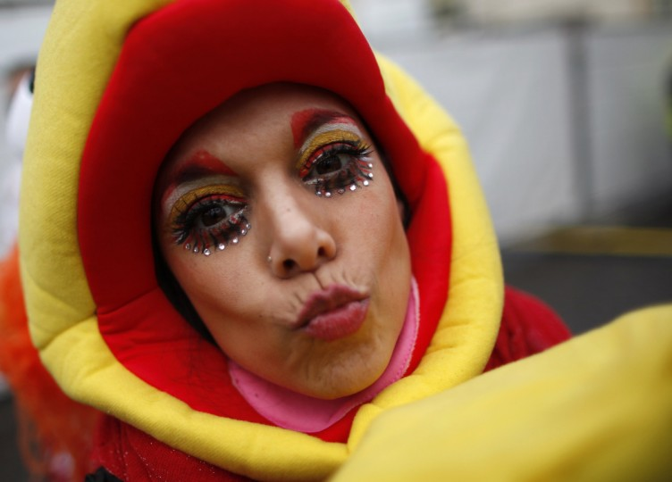 "A woman in costume celebrates ""Weiberfastnacht"" (Women's Carnival) in Cologne February 7, 2013. Women's Carnival marks the start of a week of street festivals, the highlight of the event being ""Rosenmontag"" (Rose Monday), the final day of the carnival where mass processions are held. (Ina Fassbender/Reuters)"