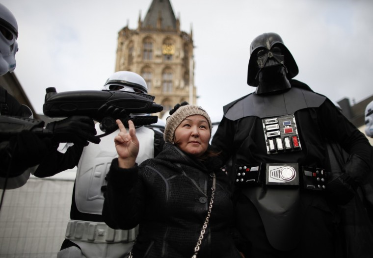 "A woman poses with a reveler dressed as Darth Vader on ""Weiberfastnacht"" (Women's Carnival) in Cologne February 7, 2013. Women's Carnival marks the start of a week of street festivals, the highlight of the event being ""Rosenmontag"" (Rose Monday), the final day of the carnival where mass processions are held. (Ina Fassbender/Reuters)"