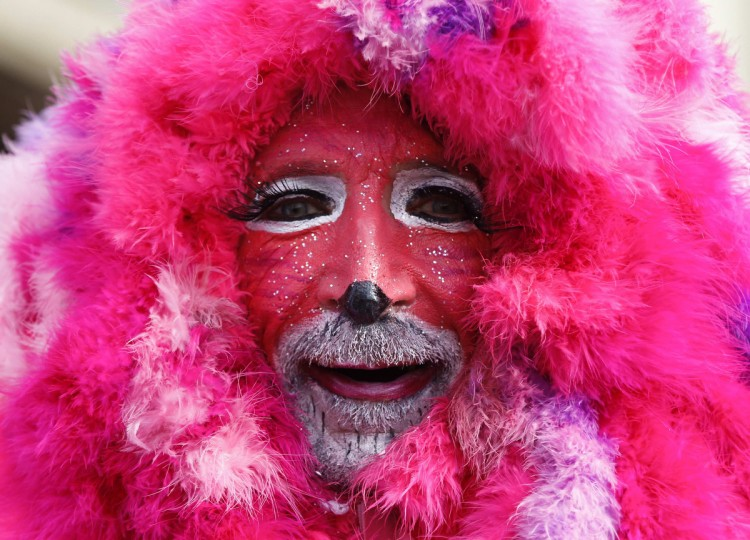 A carnival reveller celebrates at the traditional Rose Monday carnival parade in the western German city of Duesseldorf. The Rose Monday parades in Cologne, Mainz and Duesseldorf are the highlight of the German street carnival season. (Ina Fassbender/Reuters)