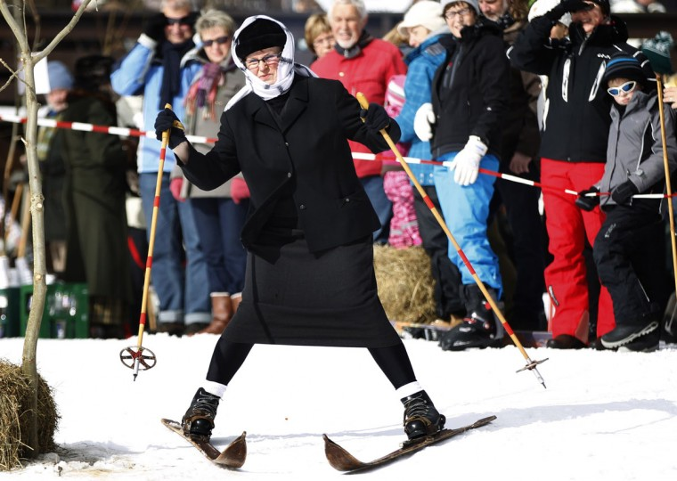 A woman competes in the 'Nostalgic Ski Race' in the western town of Neuastenberg February 17, 2013. The 'Nostalgic Ski Race' is held every two years with about 40 participants and is organized by the ski club of Neuastenberg, a town which was founded in 1713. The conditions for the participation of the race are vintage skis and dresses. (Ina Fassbender/Reuters)