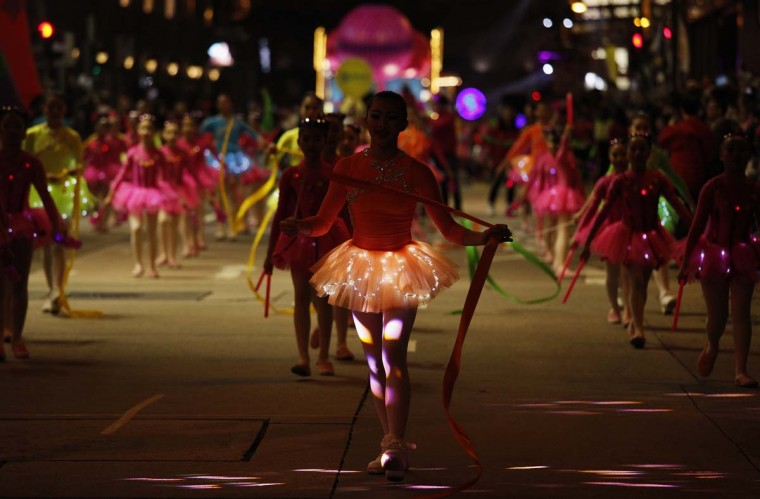 Ballet dancers take part in a Chinese New Year evening parade at Hong Kong's Tsim Sha Tsui shopping district February 10, 2013. Participants from 14 countries and regions join the parade on Sunday to celebrate the first day of the Year of the Snake, according to the Chinese Zodiac. (Bobby Yip/Reuters)