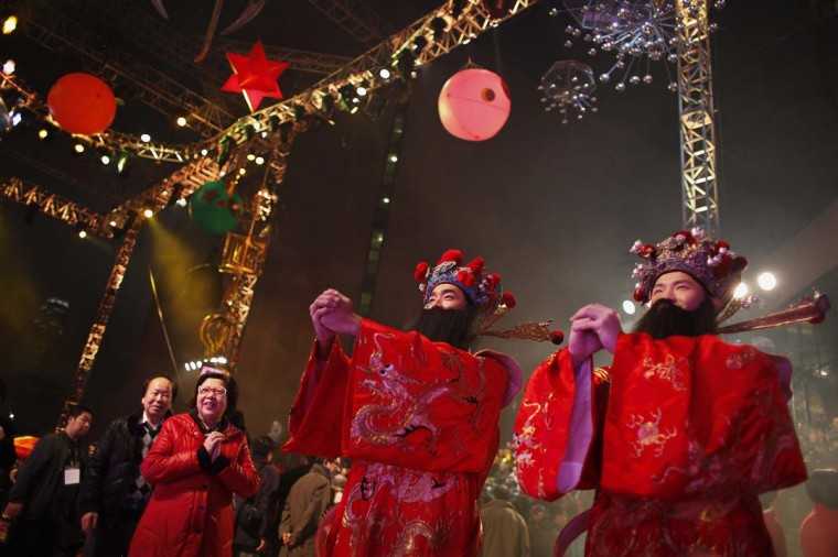 Performers dressed as the Wealth of God greet spectators during a Chinese New Year evening parade at Hong Kong's Tsim Sha Tsui shopping district February 10, 2013. Performers from 14 countries and regions took part in the parade on Sunday to celebrate the first day of the Year of the Snake, according to the Chinese Zodiac. (Bobby Yip/Reuters)
